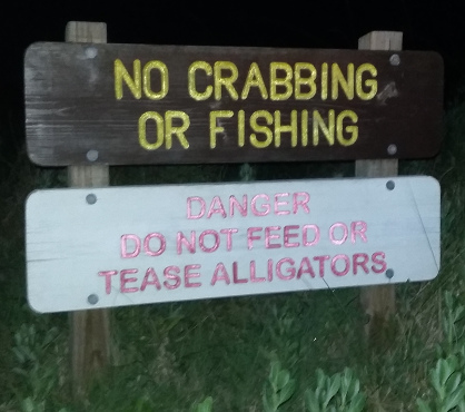 Sign says don''t get near the alligators