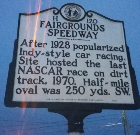 sign says last NASCAR race on dirt track was held here