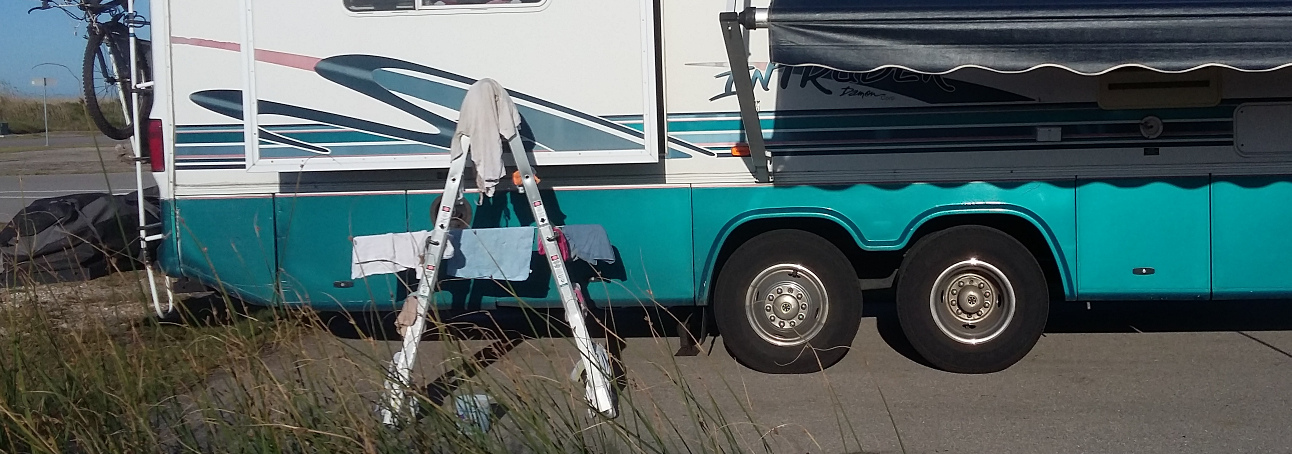 Ladder next to motorhome with clothes hanging on it