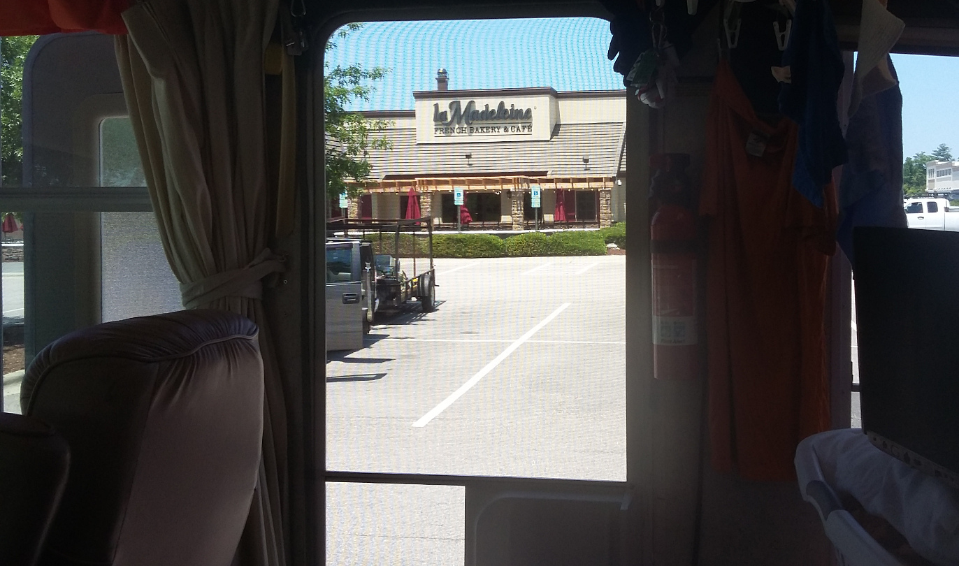 A La Madeline bakery, almost ready for opening, as seen through our screen door